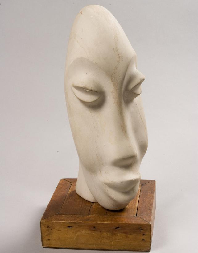 "Lucas SITHOLE LS6312 ""Head in white"", 1963 - Swazi sandstone 30cm H (img. Bonhams)"