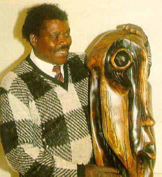 "Lucas SITHOLE LS8803 ""Oh Lord, give us the power and grace (peace) to bring up our children!"", 1988 - Indigenous wood from Zululand - illustrated in BONA, Durban, March 1989, with Lucas SITHOLE"